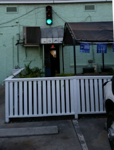 Pic of the back of a local dive. Green traffic light means bar's open
